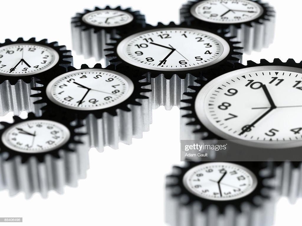 Clocks shaped like cogs : Stock Photo