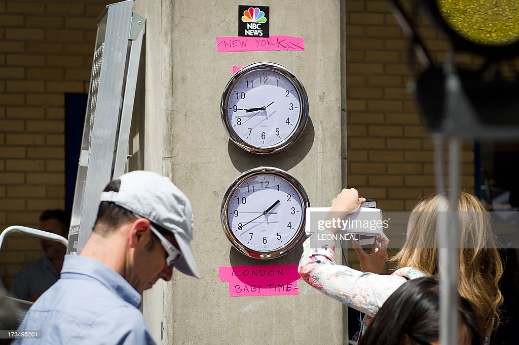 Clocks showing New York and 'London Baby Time' are hung on a wall in the media pen outside the Lindo Wing of Saint Mary's Hospital in London, on July 15, 2013, where Prince William and his wife Catherine's baby will be born. The hospital is ready, the Wikipedia page and Twitter accounts are up and Britain's famously creative press are running out of ideas. But Sunday arrived with no sign of the royal baby.