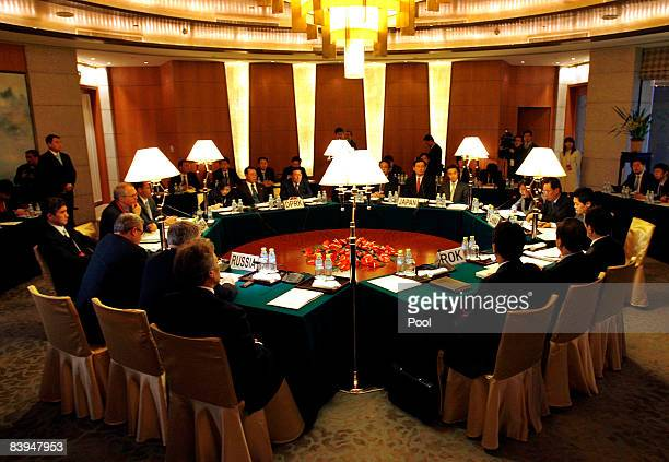 Clockwise Envoys from the Russia United States North Korea Japan China and South Korea meet at the beginning of a round of six party talks December 8...