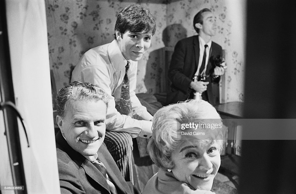 English actress Dora Bryan American evangelical Christian evangelist Billy Graham and British pop singer Cliff Richard on the set of 'Two a Penny'...