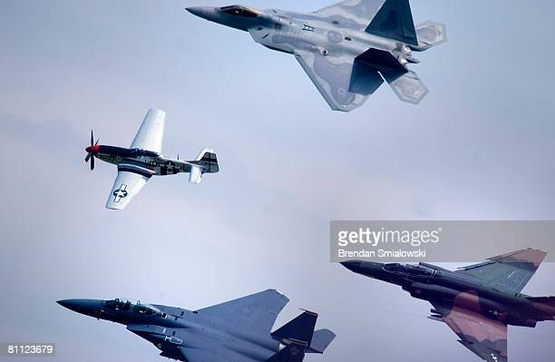 Clockwise from bottom left a F15 flies with a P51 an F22 and an F4 during the Joint Services Open House and Air Show May 16 2008 at Andrews Air Force...