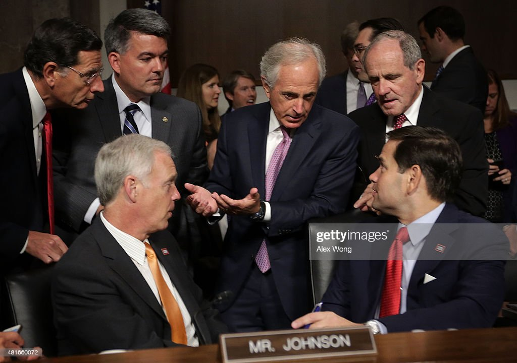 Clockwise from center top, committee Chairman Sen. <a gi-track='captionPersonalityLinkClicked' href=/galleries/search?phrase=Bob+Corker&family=editorial&specificpeople=3986296 ng-click='$event.stopPropagation()'>Bob Corker</a> (R-TN) talks to Sens. James Risch (R-ID), <a gi-track='captionPersonalityLinkClicked' href=/galleries/search?phrase=Marco+Rubio+-+Politician&family=editorial&specificpeople=11395287 ng-click='$event.stopPropagation()'>Marco Rubio</a> (R-FL), <a gi-track='captionPersonalityLinkClicked' href=/galleries/search?phrase=Ron+Johnson+-+Politician&family=editorial&specificpeople=12902569 ng-click='$event.stopPropagation()'>Ron Johnson</a> (R-WI), <a gi-track='captionPersonalityLinkClicked' href=/galleries/search?phrase=John+Barrasso&family=editorial&specificpeople=5312607 ng-click='$event.stopPropagation()'>John Barrasso</a> (R-WY) and <a gi-track='captionPersonalityLinkClicked' href=/galleries/search?phrase=Cory+Gardner&family=editorial&specificpeople=6977442 ng-click='$event.stopPropagation()'>Cory Gardner</a> (R-CO) prior to a hearing before the Senate Foreign Relations Committee July 23, 2015 on Capitol Hill in Washington, DC. The committee is reviewing the proposed Iran nuclear agreement.
