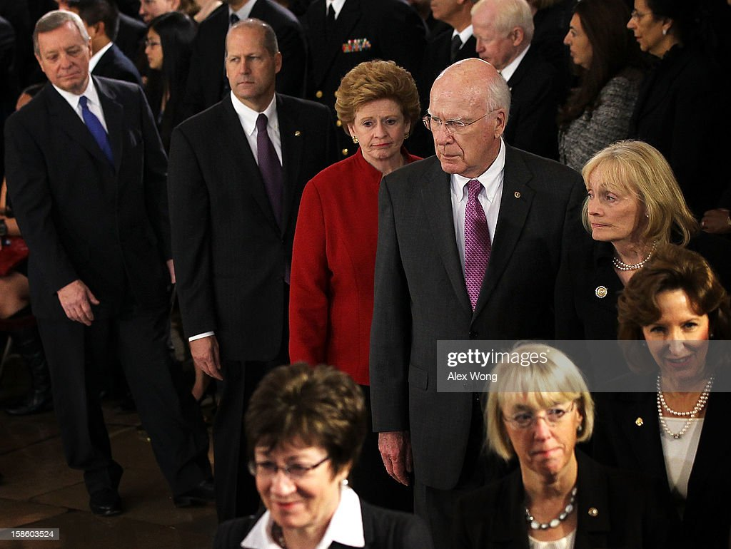 Clockwise from left, U.S. Senate Majority Whip Sen. Richard Durbin (D-IL), former Sen. John Sununu (R-NH), Sen. <a gi-track='captionPersonalityLinkClicked' href=/galleries/search?phrase=Debbie+Stabenow&family=editorial&specificpeople=221624 ng-click='$event.stopPropagation()'>Debbie Stabenow</a> (D-MI), Senator and President Pro Tempore Patrick Leahy (D-VT), Leahy's wife Marcelle Pomerleau, Sen. Kay Hagen (D-NC), Sen. <a gi-track='captionPersonalityLinkClicked' href=/galleries/search?phrase=Patty+Murray&family=editorial&specificpeople=532963 ng-click='$event.stopPropagation()'>Patty Murray</a> (D-WA), and Sen. <a gi-track='captionPersonalityLinkClicked' href=/galleries/search?phrase=Susan+Collins+-+Politician&family=editorial&specificpeople=212962 ng-click='$event.stopPropagation()'>Susan Collins</a> (R-ME) wait in-line to bid farewell to U.S. Senator Daniel Inouye (D-HI) as he lies in state in the Rotunda of the U.S. Capitol during a service December 20, 2012 on Capitol Hill in Washington, DC. The late Senator had died at the age of 88 on Monday at the Walter Reed National Military Medical Center in Bethesda, Maryland where he had been hospitalized since early December. A public funeral service will be held at the Washington National Cathedral on Friday for Senator Inouye, a World War II veteran and the second-longest serving senator in history. His remains will be returned and laid to rest in his home state.