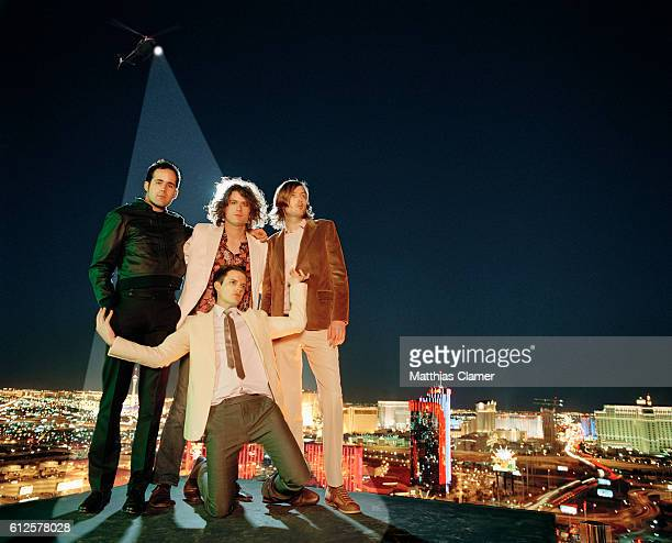 Ronnie Vannucci Dave Keuning Mark Stoermer and Brandon Flowers Styling by Julie Ragolia Grooming by Kumi Craig On Brandon pink buttondown shirt by...
