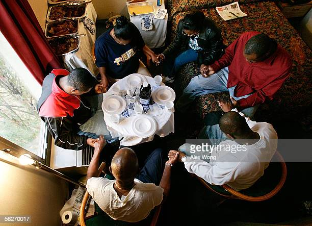Clockwise from upper left hurricane Katrina evacuee Kathy Curry of New Orleans niece Shan CurryToney family friend and evacuee Rashaad Rankins son...
