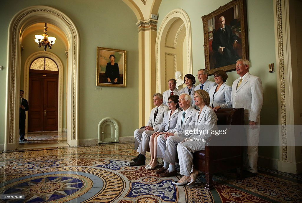 Clockwise from upper left, U.S. Sen. Johnny Isakson (R-GA), Sen. Dianne Feinstein (D-CA), Senate Majority Leader Sen. Mitch McConnell (R-KY), Sen. Amy Klobuchar (D-MN), Sen. Roger Wicker (R-MS), Sen. Shelley Capito (R-WV), Sen. Thad Cochran (R-MS), Sen. Susan Collins (R-ME), and Sen. Bill Cassidy (R-LA) pose for a National Seersucker Day group photo at the U.S. Capitol June 11, 2015 in Washington, DC. The group photo is an annual event introduced by Mississippi Sen. Trent Lott in the late 90s to revive a long-forgotten tradition of wearing seersucker suit which was considered mandatory summer attire of the Senate.