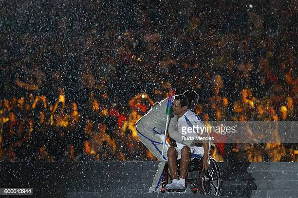 Clodoaldo Silva is embraced by singer Seu Jorge after lighting the cauldron during the Opening Ceremony of the Rio 2016 Paralympic Games at Maracana...