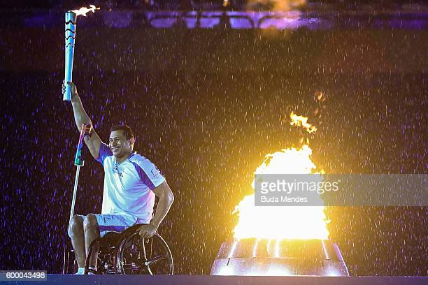 Clodoaldo Silva lights the cauldron during the Opening Ceremony of the Rio 2016 Paralympic Games at Maracana Stadium on September 7 2016 in Rio de...