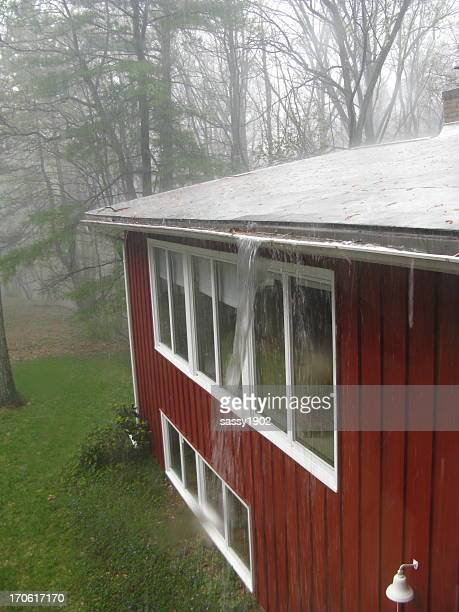 Clogged Gutter Downspout  Rain Storm House