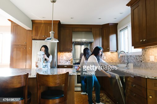 Clone image of a teenage girl in the kitchen