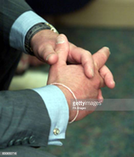 Closde up of the Prince of Wales wearing a white friendship bracelet at the Ty Hafan Children's Hospice Sully south Wales The Prince who met staff...