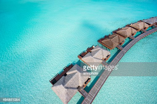 close aerial overtware bungalows in lagoon