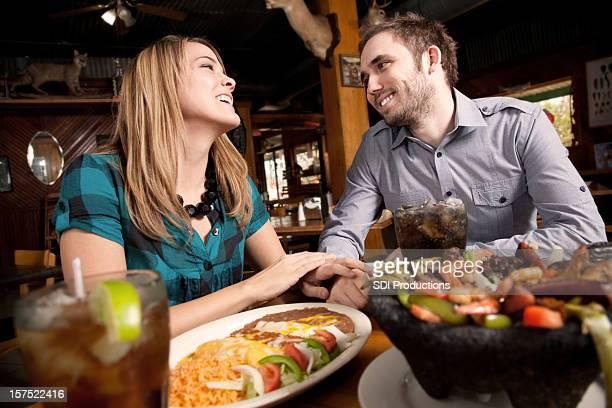 Close Couple Enjoying Dinner at a Mexican Food Restaurant