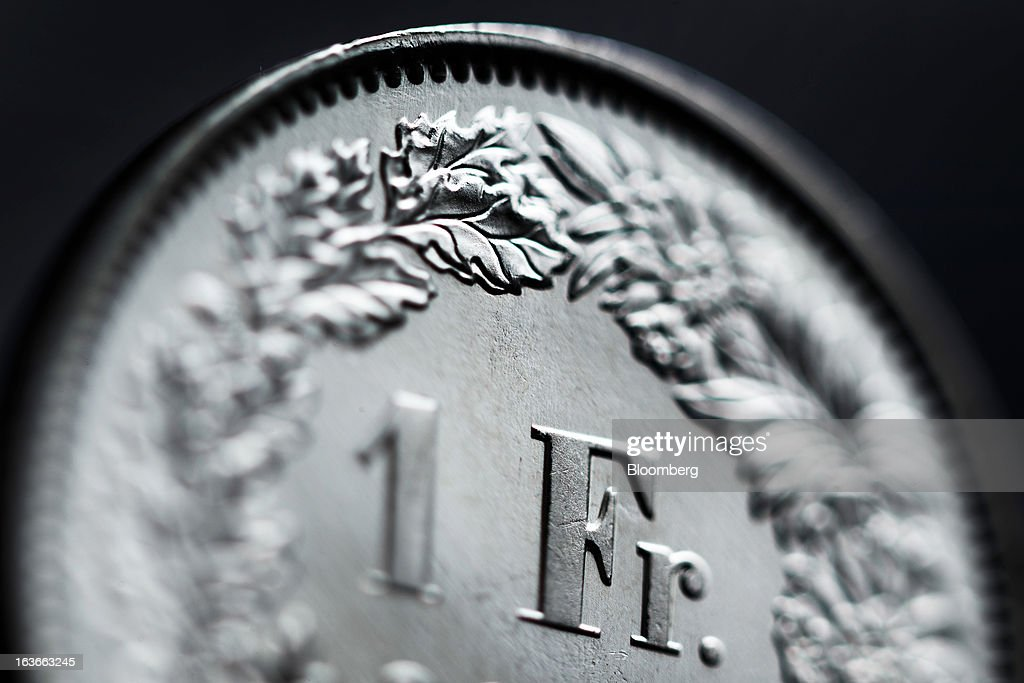 Close detail is seen on a Swiss one franc coin in this arranged photograph in Lavigny, Switzerland, on Wednesday, March 13, 2013. The Swiss central bank pledged to keep up its defense of the franc cap after almost doubling its currency holdings to shield the country from the fallout caused by the euro zone's crisis. Photographer: Valentin Flauraud/Bloomberg via Getty Images