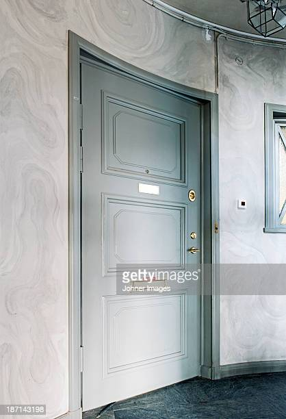 Close entrance door at home