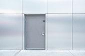 close grey door with aluminium or steel wall
