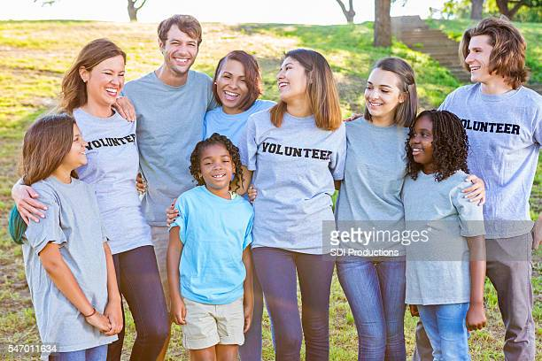 Close group of volunteers laughing together
