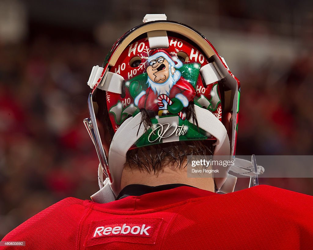 A close look at the back plate of goalie mask Petr Mrazek #34 of the Detroit Red Wings during a NHL game against the Colorado Avalanche on December 21, 2014 at Joe Louis Arena in Detroit, Michigan. The Avalanche defeated the Wings 2-1 in a shootout
