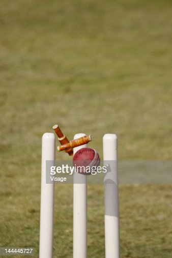 Close of a ball hitting the stumps