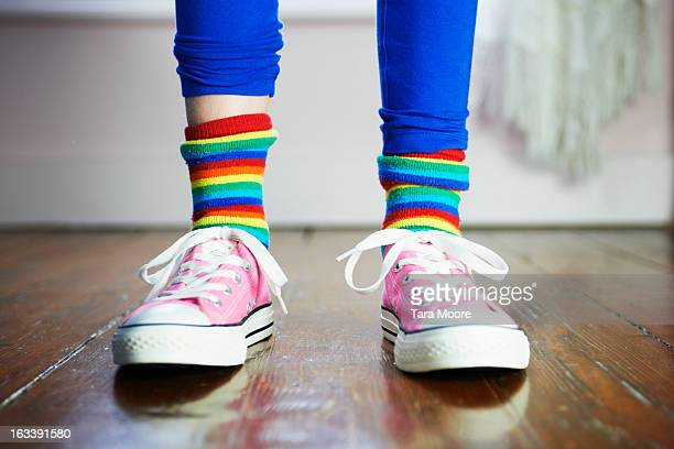 close of of child's feet wearing colourful socks