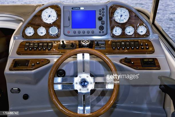 Close of of cockpit on boat showing GPS Marins chart plotter device for maritime navigation