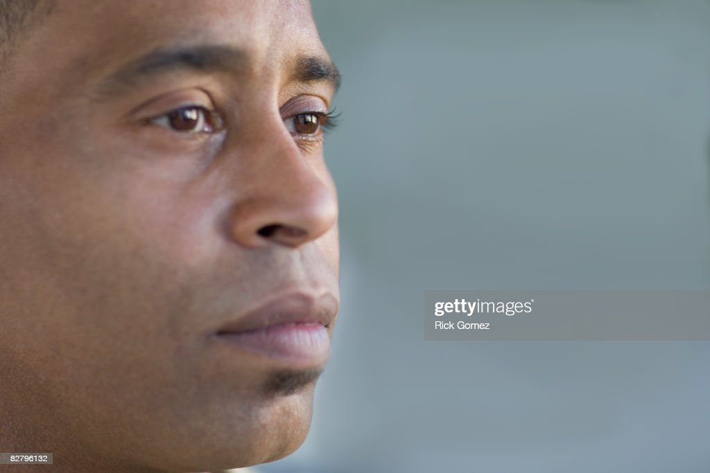 Close of up African man looking pensive : Stock Photo