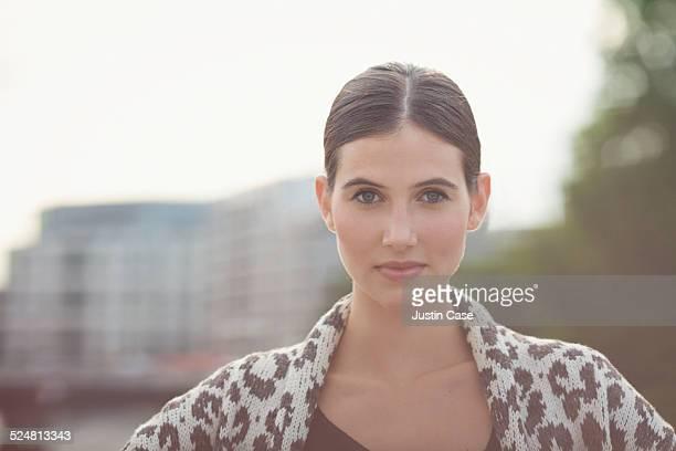 close portrait of a woman among the city sky