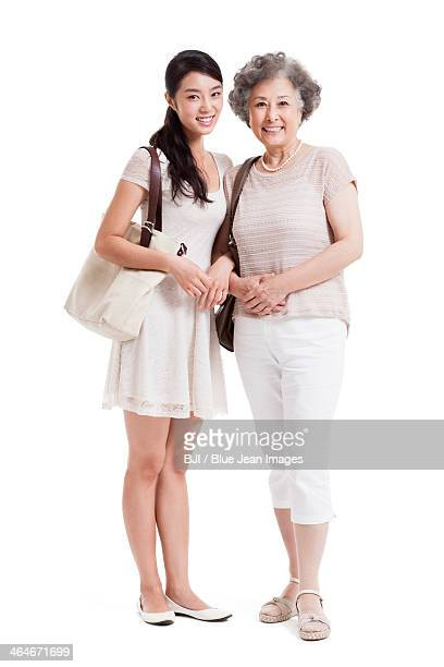 Close senior mother and adult daughter