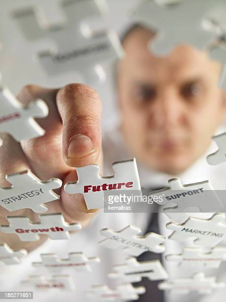 Close shot of puzzle pieces with words future and support