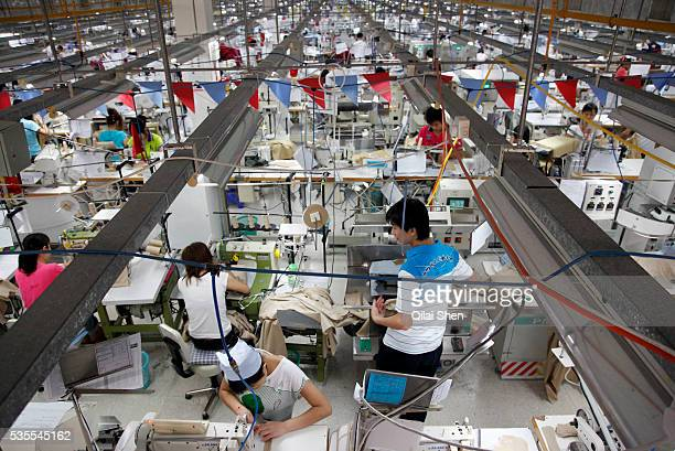 Close to a thousand employees mostly women work side by side on a production floor at a Textile Alliance Apparel factory in Qingxi Township Dongguan...