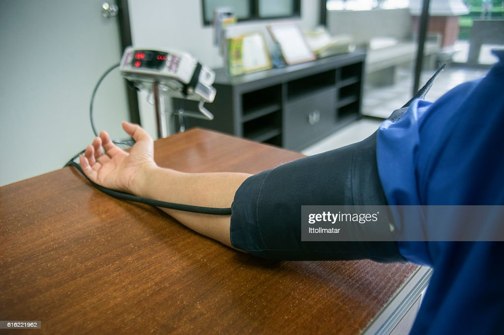 close up a right hand using a blood pressure : Stock Photo