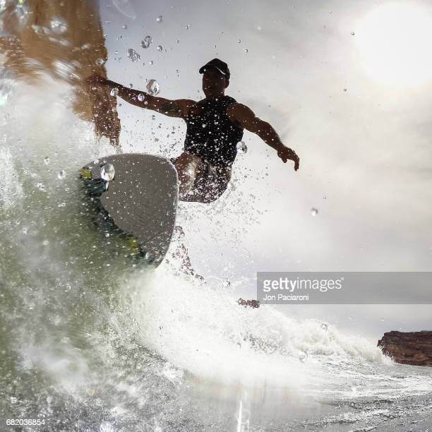 Close Up action Silhouette of a Man Surfing