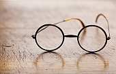 Close up antique round glasses on wooden table