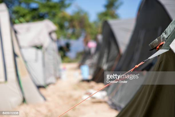 PortauPrince Haiti December 09 2012 Close up at a string that stabilize a tent in the refugee camp Parc Colofe in PortauPrince The camp exist since...