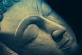 Close up beautiful sleeping Buddha face with painting art effect.