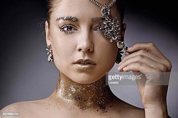 close up beautiful woman posing with luxury jewellery
