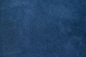 Close up blue color crumpled leather texture background.