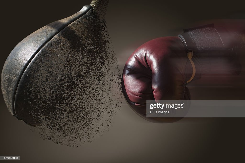 Close up boxer and punch bag with blurred motion