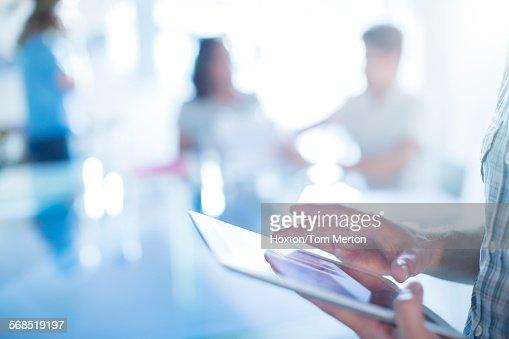 Close up businessman using digital tablet