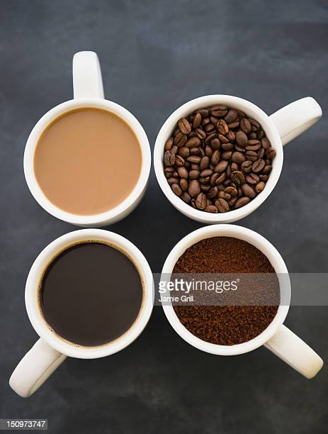 Close up coffee cups with coffee and roast coffee beans