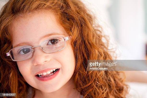 Close Up Color Image of Happy Girl Wearing Glasses