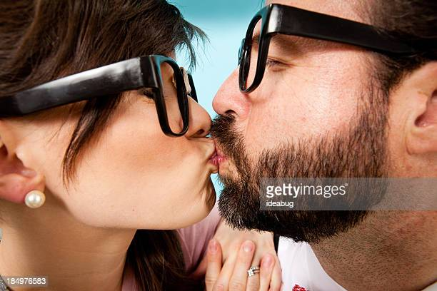 Close Up Color Image of Happy, Nerdy Couple Kissing