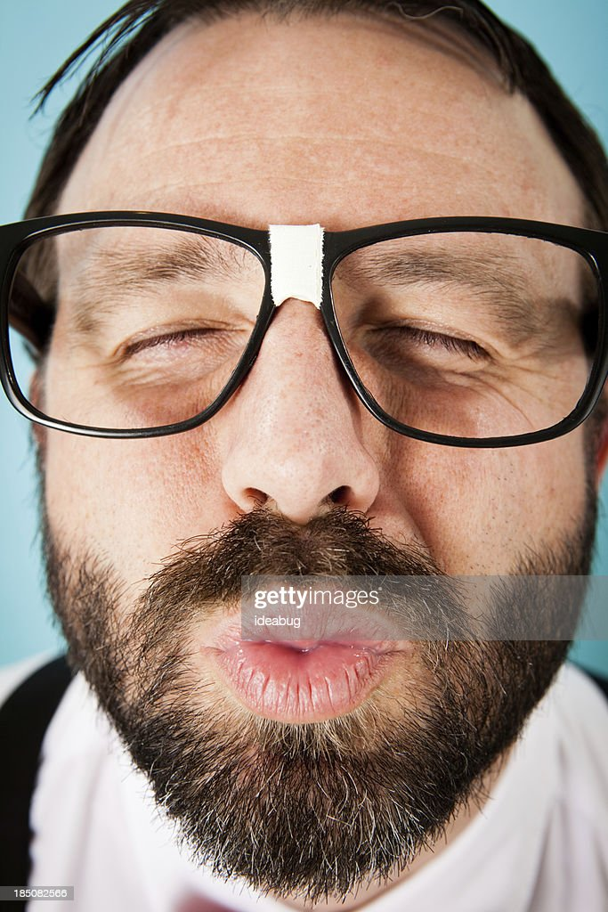 Close Up Color Image of Nerdy Guy Puckering for Kiss : Stock Photo
