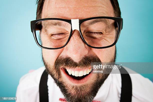 Close Up Color Image of Nerdy Guy With Cheesy Grin