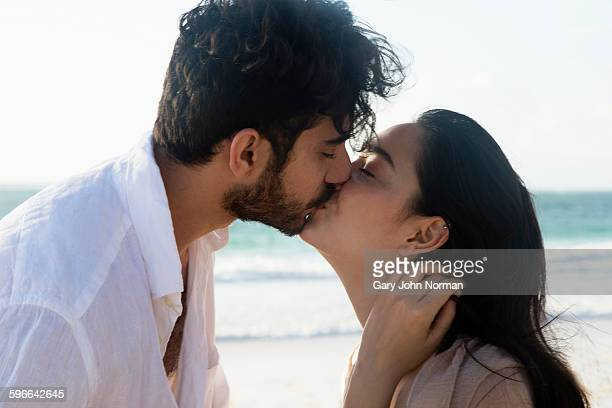 Close up couple kissing on a beach