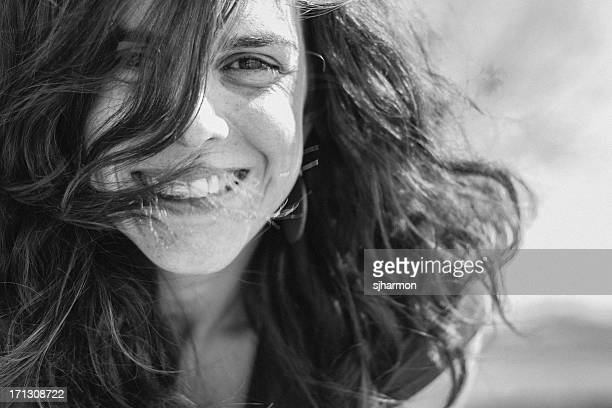 Close Up Dark Long Haired Beautiful Woman Smiling With Joy