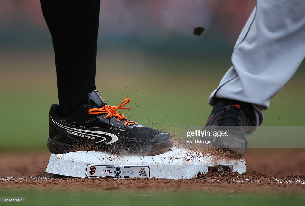 Close up detail of Brandon Belt #9 of the San Francisco Giants stepping on first base wearing Under Armour cleats during the game against the Miami Marlins at AT&T Park on Sunday, June 23, 2013 in San Francisco, California.