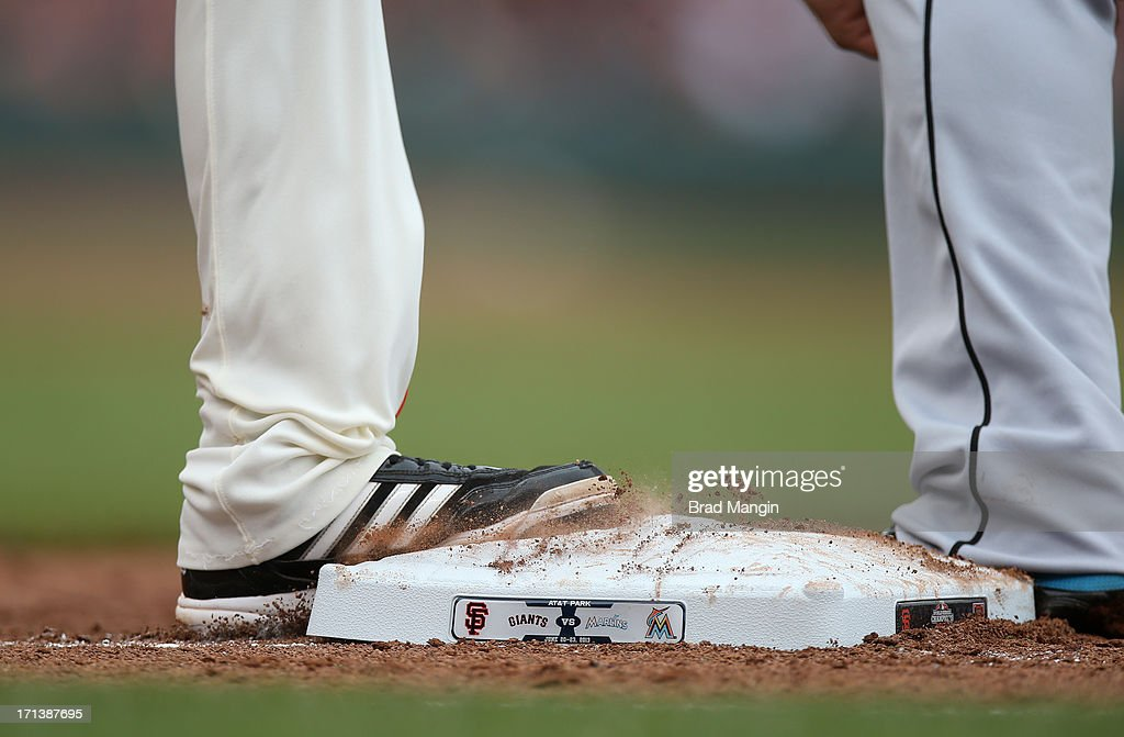 Close up detail of Nick Noonan 219 of the San Francisco Giants stepping on first base wearing Adidas cleats during the game against the Miami Marlins at AT&T Park on Sunday, June 23, 2013 in San Francisco, California.