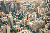 Close up detail of skyscrapers the business district of Johannesburg - Aerial view of modern buildings of the skyline in South Africa biggest city with southafrican flag painted on structure walls