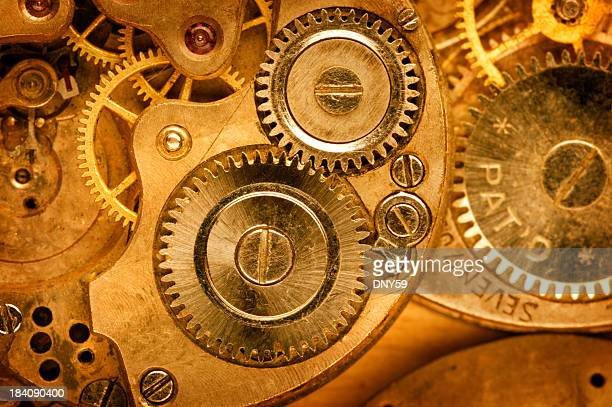Close up golden watch machinations